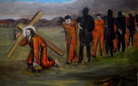 Il crocifisso con la tuta arancione